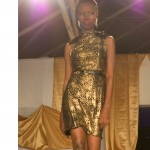 bn fashion show gold-black spotted dress with black belt runway walk